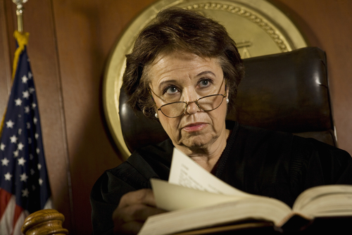 judge reading criminal sentence