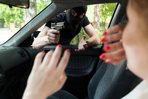 woman getting carjacked