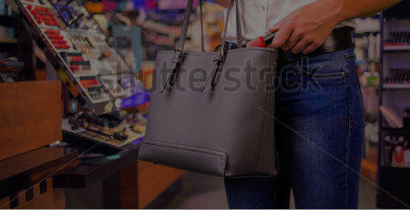 stock-photo-young-woman-is-stealing-goods-in-a-shop-320228909