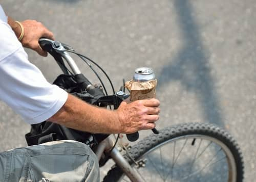 drinking alcohol on bicycyle