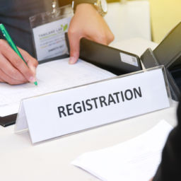 Man at registration desk